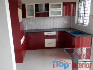 Maroon and white high glossy modular kitchen