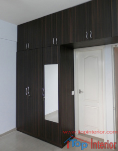 Black colour wardrobe with loft and mirror on door