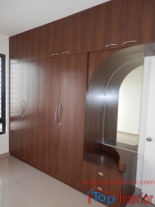 Brown colour wardrobe with loft and dressing unit