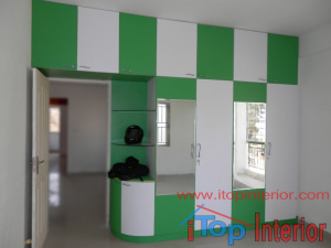 Green and white colour wardrobe with mirror on doors