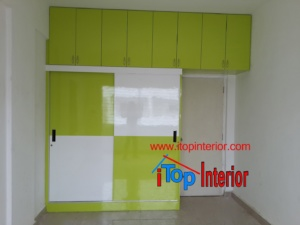 Lime green and white wardrobe with sliding doors